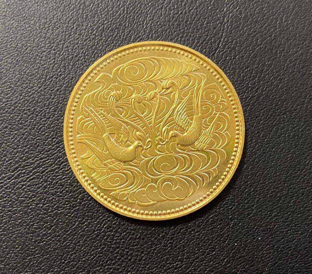 天皇陛下御在位60年記念 10万円金貨をお買取させていただきました。